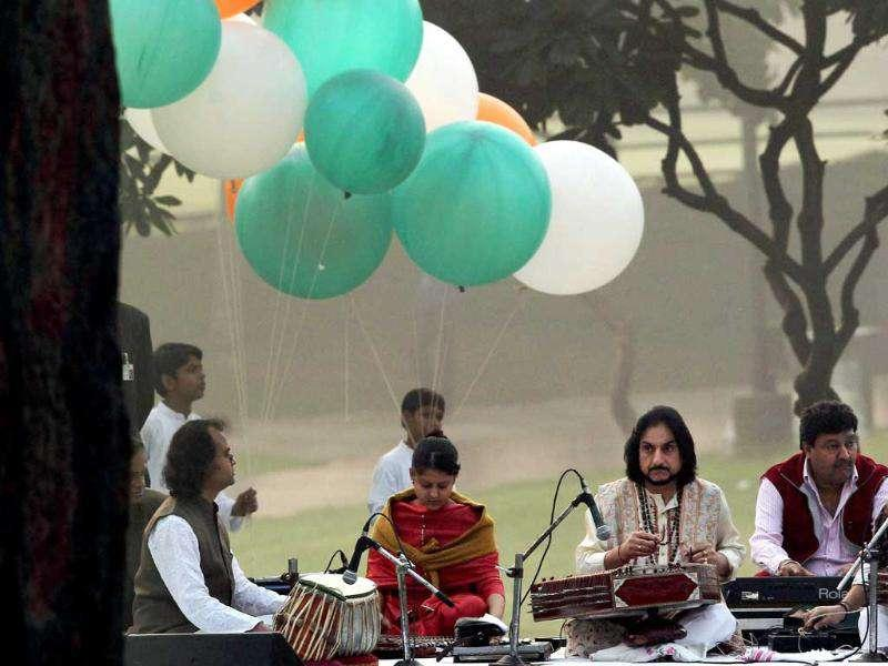 Santoor maestro Pt Bhajan Sopori along with his son Abhay Rustam Sopori performs at Shakti Sthal on the occasion of 94th birth anniversary of former prime minister the late Indira Gandhi, in New Delhi.