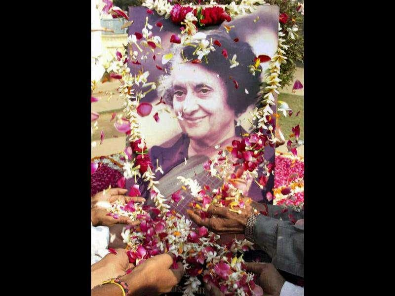 Congress workers pay tribute to the former prime minister the late Indira Gandhi on her birth anniversary at Anand Bhawan in Allahabad.