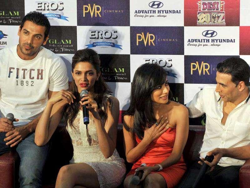 Bollywood actors John Abraham, Deepika Padukone, Chitrangada Singh and Akshay Kumar address the media during a promotional press conference for their upcoming film Desi Boyz in Bangalore. (AFP)