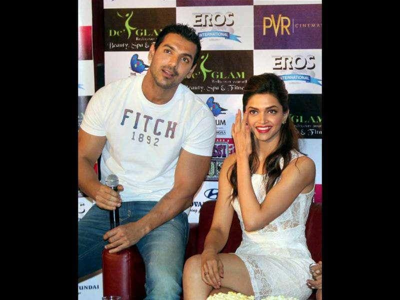 Deepika, John pose together at the press meet. (AFP)