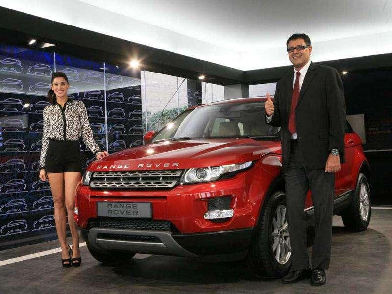Bollywood actor Nargis and Rohit Suri, Head of the Premier Car Division, Jaguar Land Rover India, launch the Range Rover Evoque.