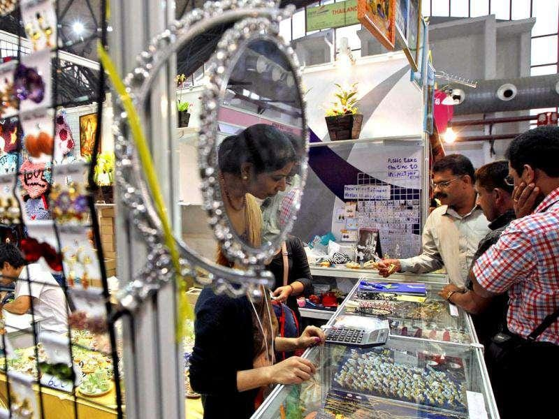 A woman looks at jewelry products at the foreign pavilion during the 31st India International Trade Fair (IITF) in New Delhi.