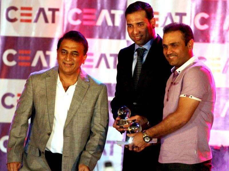 Winner of the Ceat Special Award for contribution to Indian Cricket V V S Laxman and winner of the Special Award for completing 10 years in International cricket Virendra Sehwag chat with Sunil Gavaskar during the awards ceremony in Mumbai.