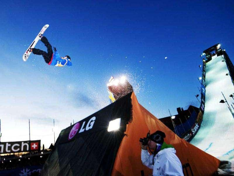 Third placed Russia's Alexey Sobolev jumps during the Snowboard Big Air FIS World Cup 2012 competition in Stockholm Stadium on November 19, 2011. AFP Photo/Jonathan Nackstrand