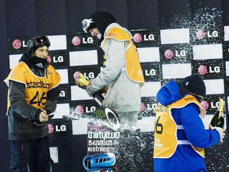 Sweden's Niklas Mattsson (C) celebrates his victory in the Snowboard Big Air FIS World Cup 2012 competition in Stockholm with second-placed Austria's Macho Michael (L) and third-placed Russia's Alexey Sobolev in Stockholm on November 19, 2011. AFP Photo / Jonathan Nackstrand