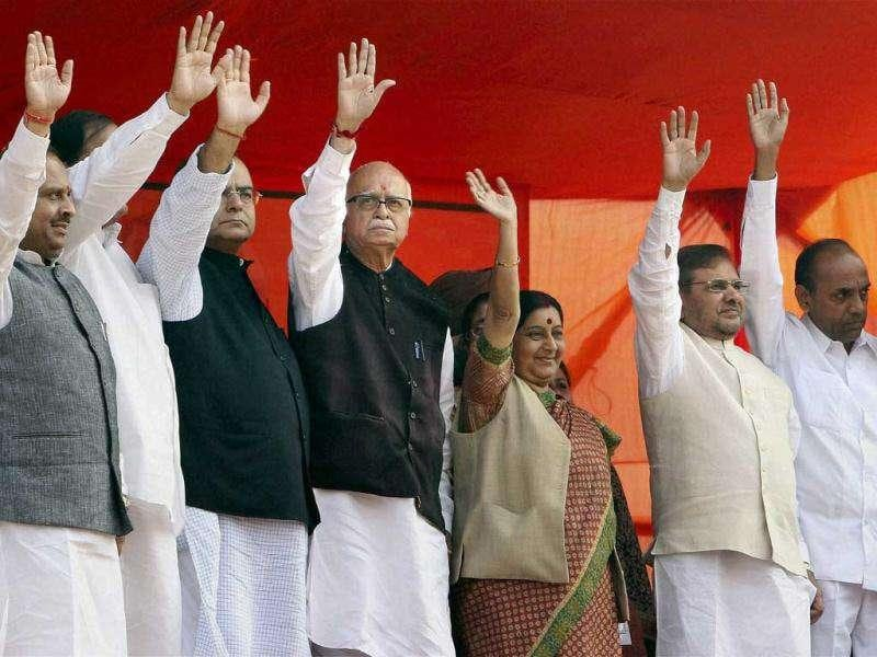 Senior BJP leader L K Advani along with other senior leader of NDA wave during last public meeting of his