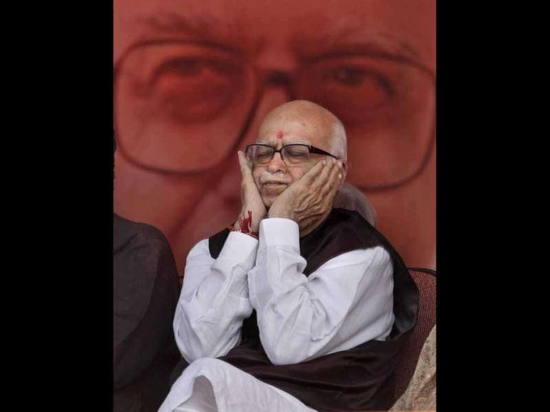 Opposition Bharatiya Janata Party (BJP) senior leader Lal Krishna Advani, gestures as he sits infront of a portrait of him at a public rally marking the end of his thirty eight day long nationwide campaign against corruption in New Delhi. AP Photo/ Manish Swarup