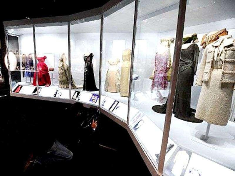 Former US First Ladies dresses are displayed at the Smithsonian's National Museum of American History in Washington, DC. The new exhibition features 26 dresses, including those worn by Frances Cleveland, Lou Hoover, Jacqueline Kennedy, Laura Bush and Michelle Obama and more than 160 other objects, including portraits, White House china, personal possessions and related objects.