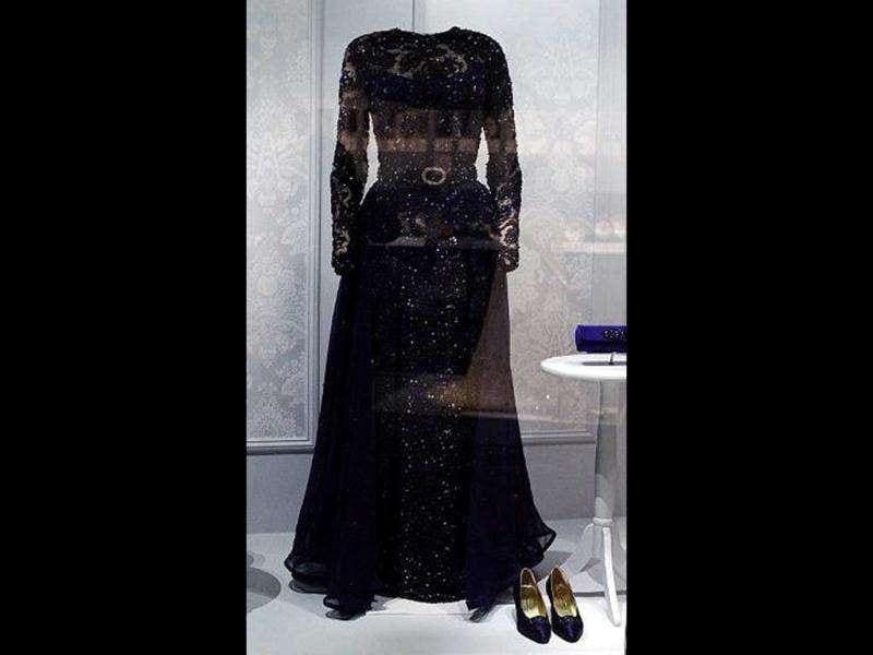 A dress and accessories of former US First Lady Hillary Clinton is displayed at the Smithsonian's National Museum of American History in Washington, DC.