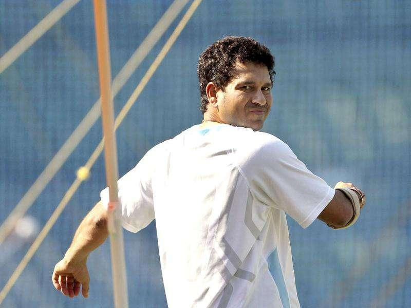 Sachin Tendulkar does stretching during a training session ahead of their third Test cricket match against West Indies in Mumbai.