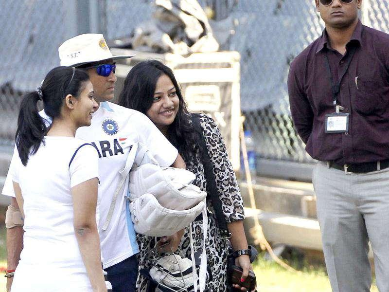 Sachin Tendulkar, second left, poses for photos with fans during a training session ahead of their third Test cricket match against West Indies in Mumbai.
