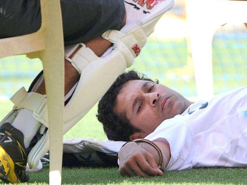 Sachin Tendulkar lies on the ground during a practice session at the Wankhede stadium in Mumbai.