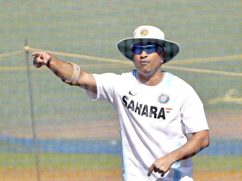 Sachin Tendulkar gestures during a training session ahead of their third Test cricket match against West Indies in Mumbai.