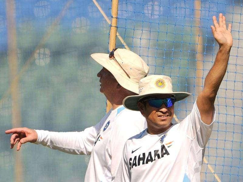 Sachin Tendukar (R) and coach Duncan Fletcher gesture during a practice session at the Wankhede stadium in Mumbai.