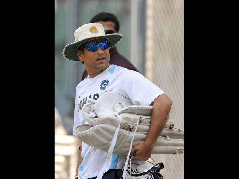 Sachin Tendulkar arrives for a practice session at the Wankhede stadium in Mumbai.