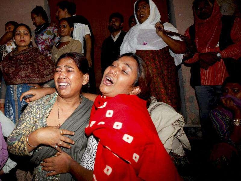 Eunuchs react after a major fire broke out at the site of their congregation in the Nand Nagri area of New Delhi.