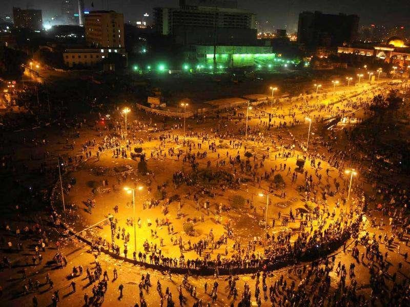 A general view shows Cairo's landmark Tahrir Square as Egyptian riot policeman try to disperse protesters. Deadly clashes broke out in central Cairo for the second day running, kicking off a violent countdown to the first elections since Hosni Mubarak's downfall.