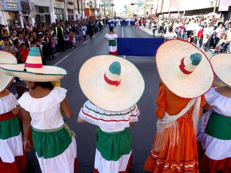 Students wearing traditional revolutionary costumes take part in 101st Mexican Revolution Anniversary parade in downtown Ciudad Juarez. Reuters Photo