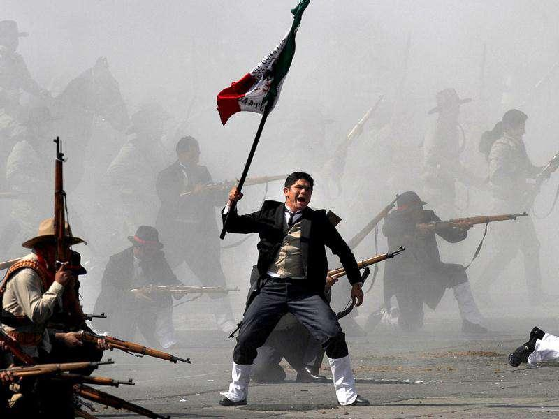 Soldiers re-enact a revolution battle as part of Mexican Revolution 101th anniversary celebrations in Mexico City's Zocalo plaza. AP Photo