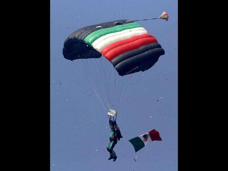 A paratrooper glides during Mexican Revolution 101th anniversary celebrations in Mexico City's Zocalo plaza. AP Photo