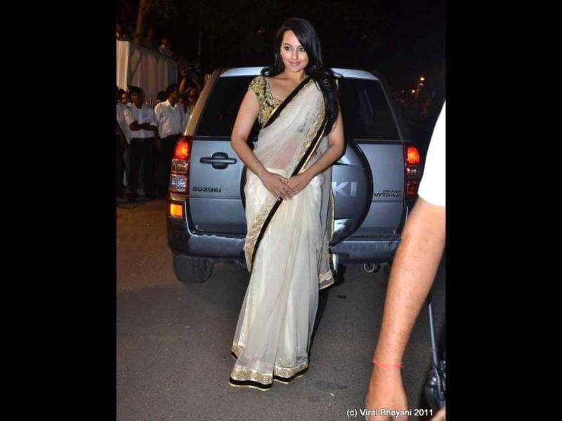 Actor Sonakshi Sinha arrives in a cream sari.