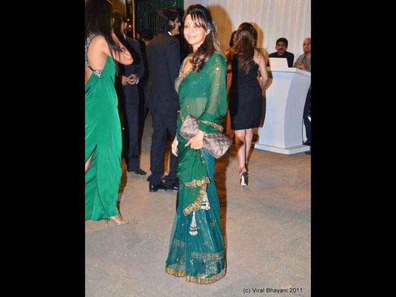 Gauri Khan looks stunning in a green see-through sari.