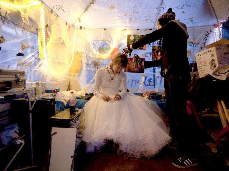 Eveline Constance Heijkamp, a 22-year-old Occupy Amsterdam demonstrator, prepares for her wedding to Gijs Peskens (not pictured) in a tent on the Beursplein in Amsterdam.