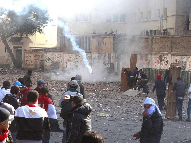 Protesters keep their distance from tear gas fired by riot police during clashes between protesters and police near Tahrir Square in Cairo. Photo: Reuters/Asmaa Waguih