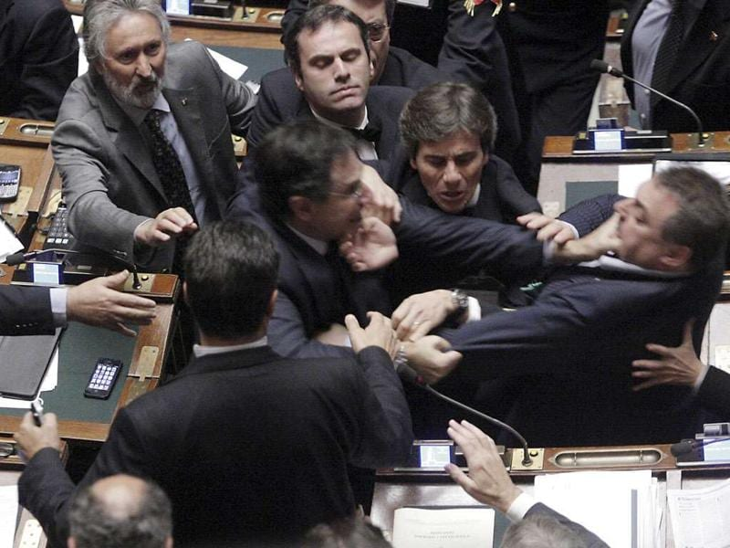 Claudio Barbato (L), a member of the opposition FLI party, fights with Fabio Ranieri (R) from the Northern League in Parliament in Rome on October 26, 2011. The Italian deputies exchanged blows in parliament as tensions over a tough economic reform programme came to a head.