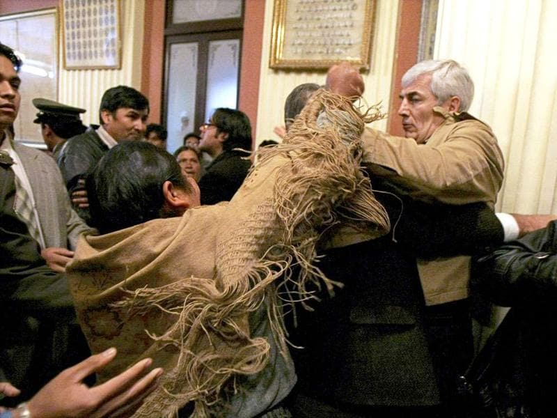 Bolivian opposition congressman Fernando Rodriguez battles with an unidentified indigenous deputy of President Evo Morales' party during a congress session in La Paz on April 9, 2009.