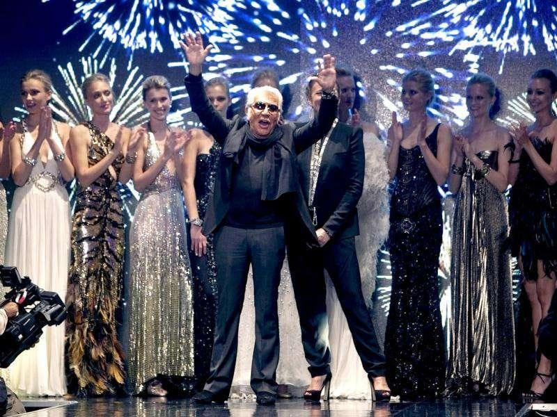 Italian designer Roberto Cavalli (C) reacts at the end of his collection's fashion show during the Fashion Week in Tel Aviv. Reuters