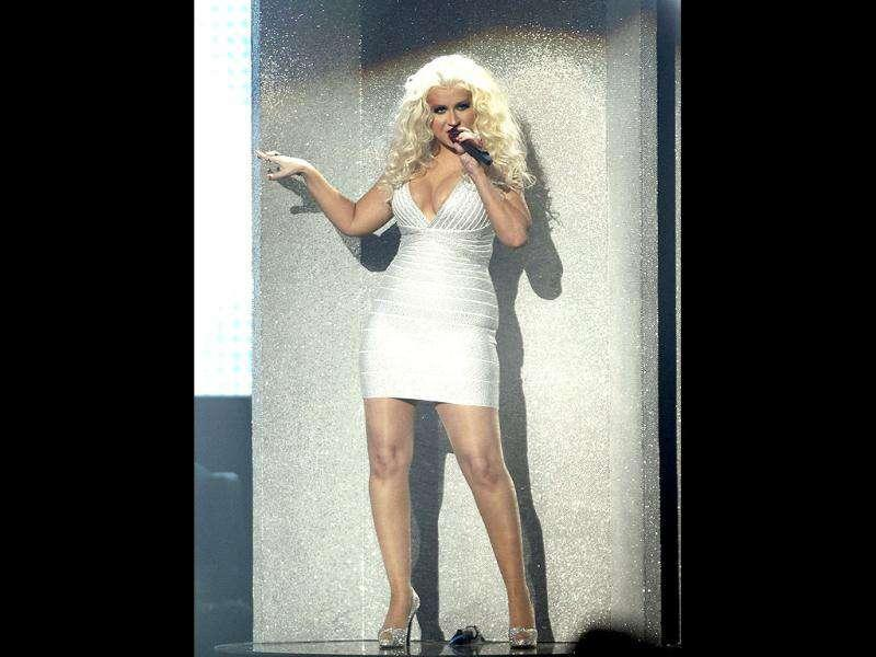 Christina Aguilera looks scary oozing out of her bandage dress and her frizzy golden hair doesn't help much either.