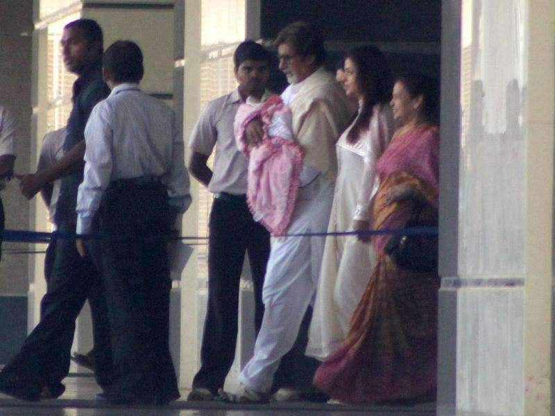Amitabh Bachchan holds his granddaughter while walking out of the hospital with daughter-in-law Aishwarya. Big B tweeted: