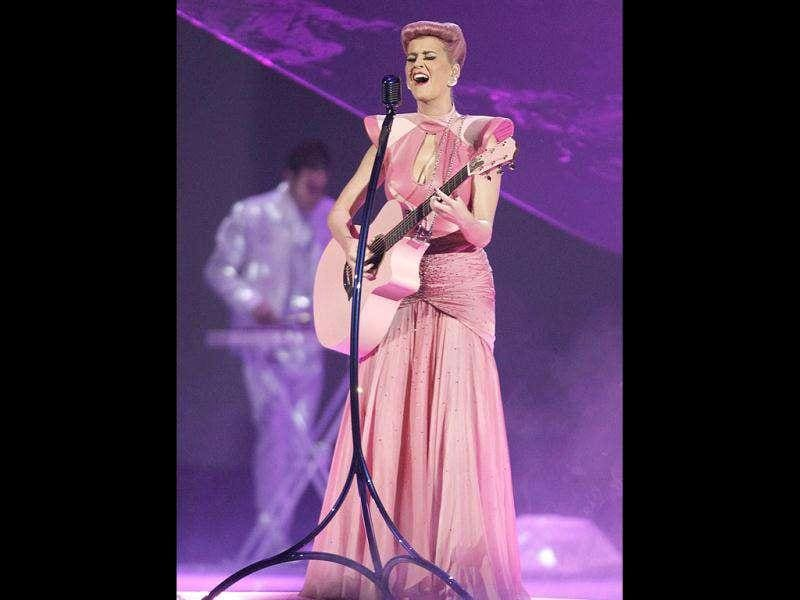 Katy Perry croons in pink yet again, this time with a pink guitar as well.