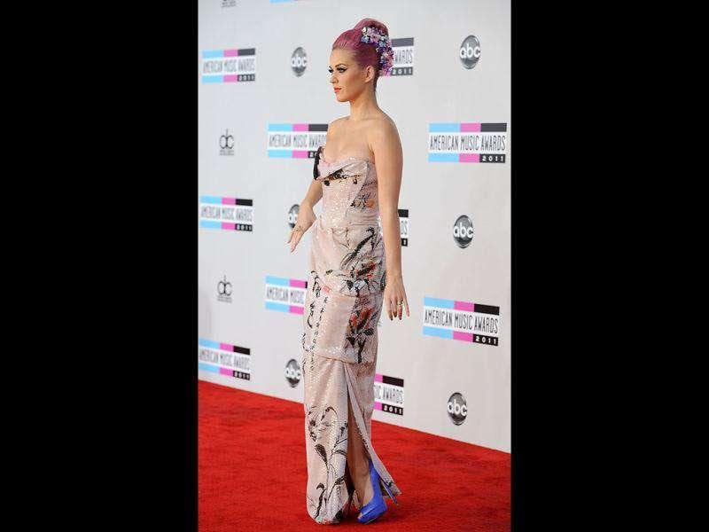 Katy Perry looks good in a piled hair-do and a pink dress.