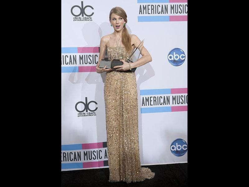 Taylor Swift having a little trouble handling so many awards.