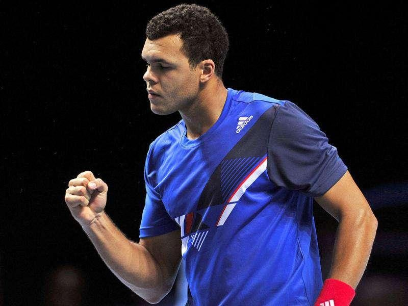 Jo-Wilfried Tsonga of France reacts after winning a point against Mardy Fish of the US during their group B singles match in the round robin stage on day three at the ATP World Tour Finals tennis tournament in London. AFP Photo/Glyn Kirk