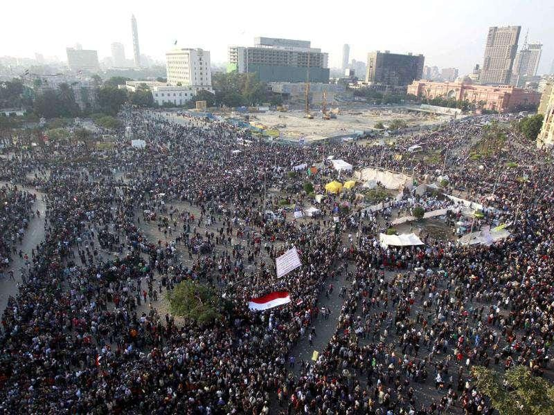 A general view of Tahrir Square, with protesters keeping their distance and fleeing from tear gas fired by riot police during clashes, while protesting against head of the ruling military council and government Field Marshal Hussein Tantawi, in Cairo. Photo: Reuters/Amr Abdallah Dalsh