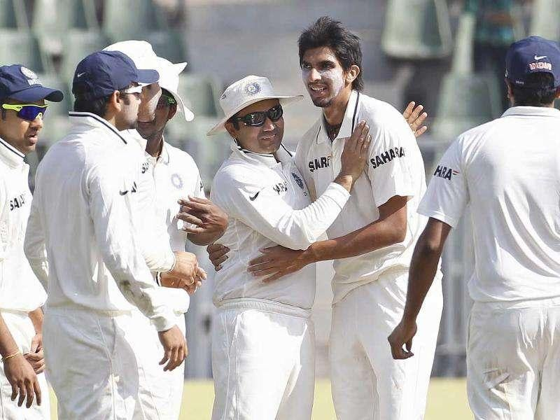 India's Ishant Sharma (2nd R) and Virender Sehwag (C) celebrate the dismissal of West Indies' Kirk Edwards with their team mates during the second day of their third test cricket match in Mumbai.