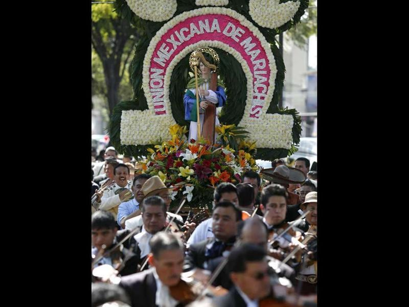 Mariachis carry a statue of Santa Cecilia, the patron saint of music, during a pilgrimage to the Basilica of Our Lady of Guadalupe in Mexico City.