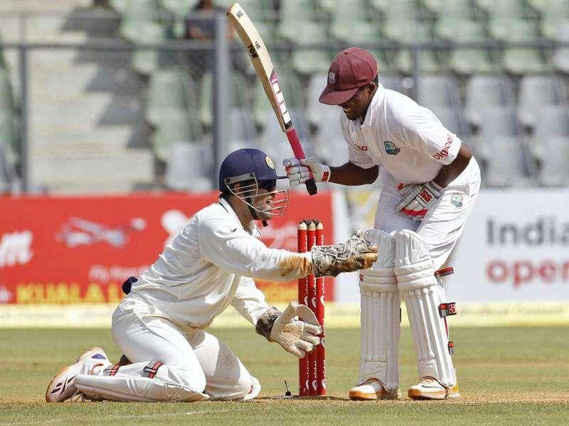 India's captain Mahendra Singh Dhoni (L) appeals unsuccessfully for the wicket of West Indies' Darren Bravo during the second day of their third test cricket match against India in Mumbai.