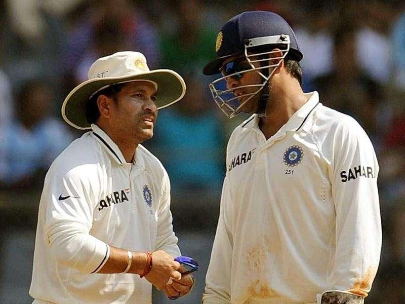 Indian captain Mahendra Singh Dhoni (R) speaks with Sachin Tendulkar during the second day of the third test cricket match between India and West Indies at the Wankhede stadium in Mumbai.