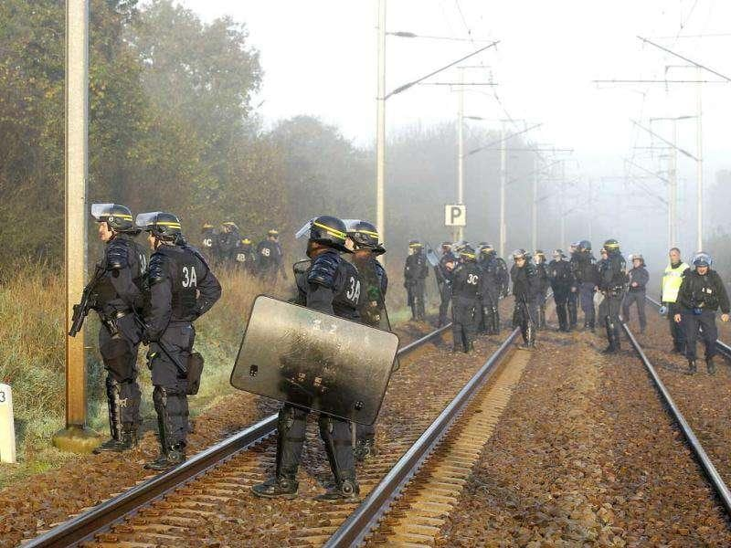 French CRS riot police walk on railway tracks before the departure of the train convoy of castor containers, which carry radioactive nuclear waste, in Lieusaint near Valognes. Reuters/Benoit Tessier