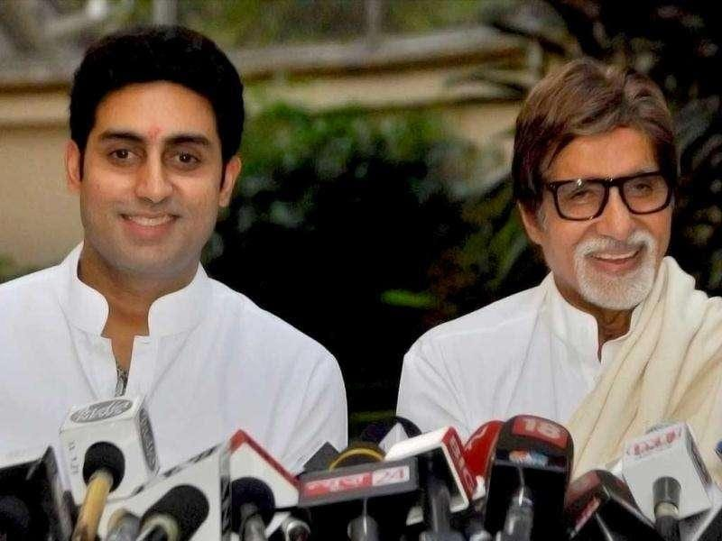 Amitabh and Abhishek Bachchan can't stop smiling while addressing a press conference after Aishwarya Rai Bachchan returned home. (PTI)