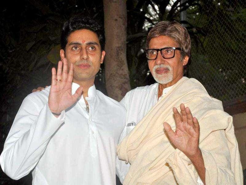 Amitabh and Abhishek share their happiness with media. (AFP)