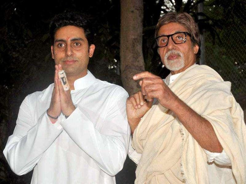 Amitabh Bachhan and his son Abhishek Bachchan pose at the press conference. (AFP)