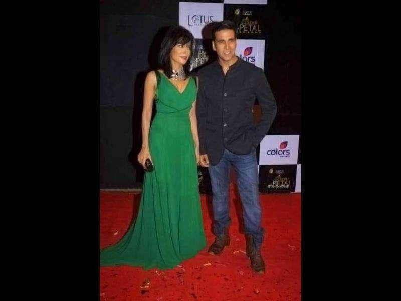 Chitrangada looks nice in a green gown with a trail.