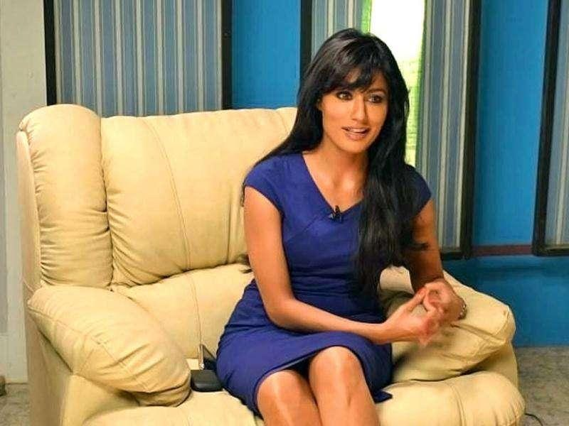Chitrangada in a short blue dress.