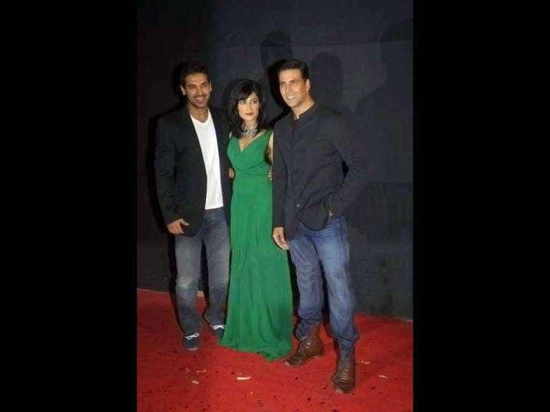 John wears a Black coat while Akshay dons a bandhgala.