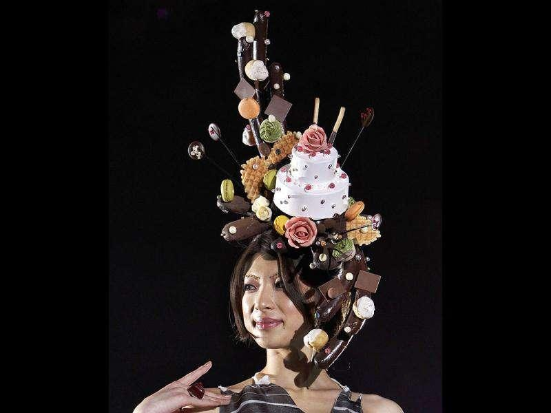A model displays a headpiece made of confectionery by Japanese patissier Rie Tanimichi during the Tokyo Sweets Collection in Tokyo. AP